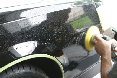Wet sanding stage in paint correction process